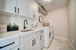 laundry room in the midland showhome by western living homes