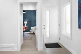 Bright White Modern Entryway in The Grahame Showhome