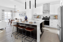 White and Black Kitchen with Modern Finishes in The Grahame Showhome in Rosewood at Secord