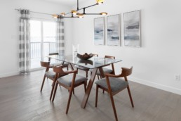 Dining Area and Doors to Backyard of The Grahame Showhome in Rosewood Edmonton