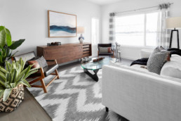 Cozy Living Room with Textiles and Plants in The Grahame Showhome at Rosewood in Secord