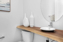 Main Floor Bathroom with Wood Countertop in The Grahame Showhome