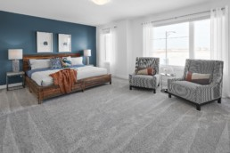 The Grahame Rosewood Showhome Master Bedroom with Blue Feature Wall